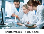 Group Of Scientists Working At...