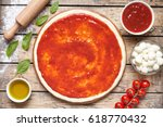 raw dough for pizza preparation ... | Shutterstock . vector #618770432
