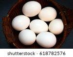 white chicken eggs in a wicker... | Shutterstock . vector #618782576