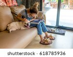 asia woman reading book on sofa ... | Shutterstock . vector #618785936