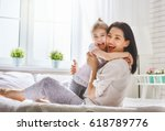 happy mother's day  mom and her ... | Shutterstock . vector #618789776