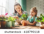 cute child girl helps her... | Shutterstock . vector #618790118