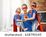 mother and her children playing ... | Shutterstock . vector #618790145