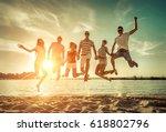 friends jumping on the beach... | Shutterstock . vector #618802796