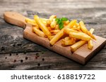 french fries on cutting board... | Shutterstock . vector #618819722
