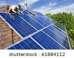 man installing alternative... | Shutterstock . vector #61884112