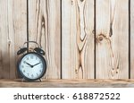 Time Concept With Alarm Clock On Wooden Shelf - stock photo