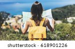 hipster tourist hold and look... | Shutterstock . vector #618901226