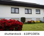 house with grass and flowers   Shutterstock . vector #618910856