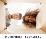 man and a girl looking into a... | Shutterstock . vector #618915662