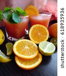 fresh juice with fruits on table | Shutterstock . vector #618935936