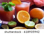 fresh juice with fruits on table | Shutterstock . vector #618935942