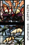 Small photo of TERVUREN, BELGIUM - MARCH 13, 2017: Stained Glass in the Church of Tervuren, Belgium, depicting a burning lamb, symbolizing the Agnus Dei