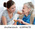 senior woman with her home... | Shutterstock . vector #61894678