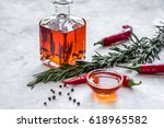 jar with oil and chili on stone ... | Shutterstock . vector #618965582