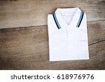 white shirt on wood background | Shutterstock . vector #618976976