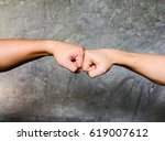 a fist bump or power five is... | Shutterstock . vector #619007612