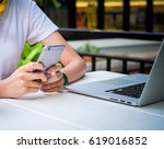 young woman texting on his... | Shutterstock . vector #619016852