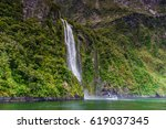 stirling waterfalls   milford... | Shutterstock . vector #619037345