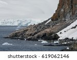 Small photo of Penguins nest in adverse conditions along the mountainous coastline of Antarctica.