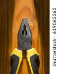 Small photo of Close up of a multitool pliers on wooden background