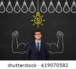 finance concepts on blackboard | Shutterstock . vector #619070582