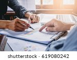 business team analyzing income... | Shutterstock . vector #619080242