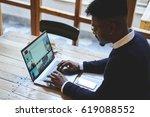 afro american male programmer...   Shutterstock . vector #619088552