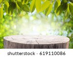 wood table with green leaves... | Shutterstock . vector #619110086