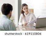 young female boss talking to... | Shutterstock . vector #619110806