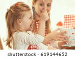 mum and daughter spending time... | Shutterstock . vector #619144652