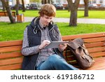 young smiling white man with a... | Shutterstock . vector #619186712