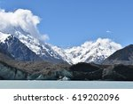 Small photo of Iceberg emerges after part of the Tasman Glacier just broke off into Lake Tasman, with Mount Cook in the background. Situated in the Hooker Valley, South Island NZ