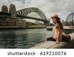 Smiling Woman Sitting In Sydne...