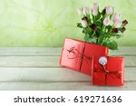 Two Red Wrapped Gifts With...