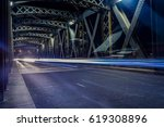 asphalt road under the steel... | Shutterstock . vector #619308896