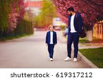 happy father and son in suits... | Shutterstock . vector #619317212