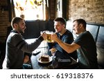 three happy young men in casual ... | Shutterstock . vector #619318376