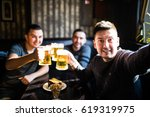 three young men in casual... | Shutterstock . vector #619319975