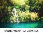 beautiful green forest waterfall | Shutterstock . vector #619326665