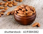 shelled almonds in a bowl on... | Shutterstock . vector #619384382