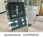 information booth at an airport | Shutterstock . vector #619392542