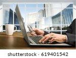 man working laptop. | Shutterstock . vector #619401542