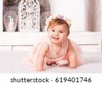 smiling baby girl wearing... | Shutterstock . vector #619401746