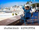 woman traveler relaxing in... | Shutterstock . vector #619419956