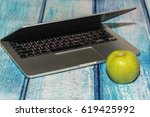 laptop with an apple on the...   Shutterstock . vector #619425992