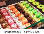 colorful chocolate candies lay... | Shutterstock . vector #619439426