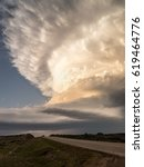 Small photo of A towering supercell thunderstorm over northwest Oklahoma range land.