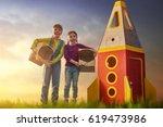 children in astronauts costumes ... | Shutterstock . vector #619473986
