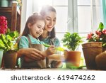 cute child girl helps her... | Shutterstock . vector #619474262